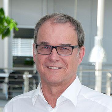 Portraitfoto vom CEO von Hoffmann + Krippner